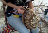 Woman Learning How To Make A Basket