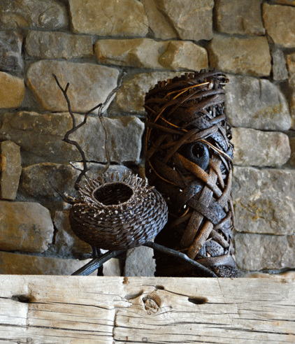 Basket And A Woven Tower Being Used As Fireplace Sculptures