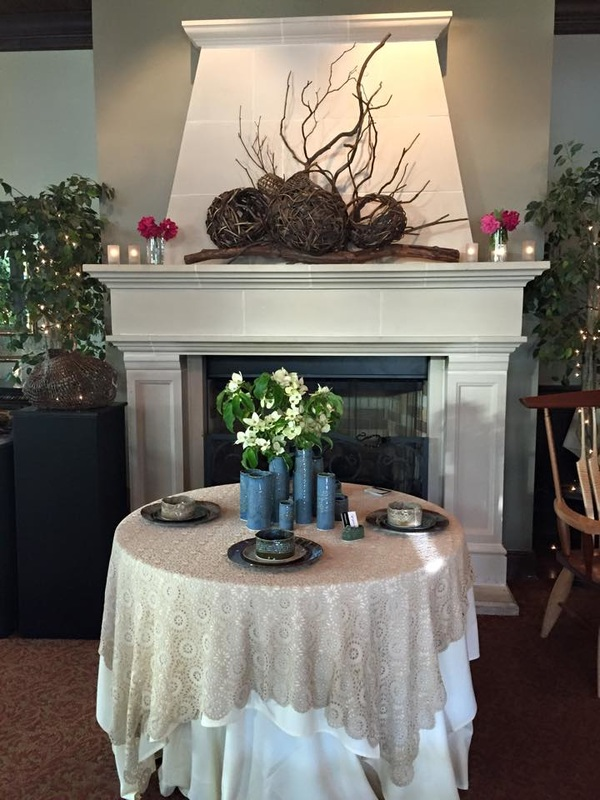 Fully Set Dinner Table In Front Of A Hearth With Fireplace Sculptures