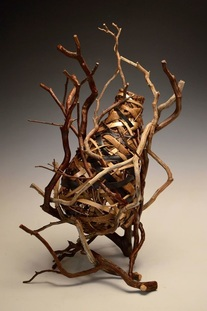 Basket With Branches That Serves As Elegant Rustic Decor