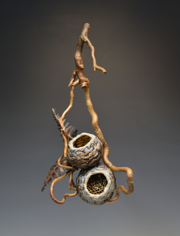 Wall hanging sculpture made using vine basket style. This is an example of modern rustic decor.