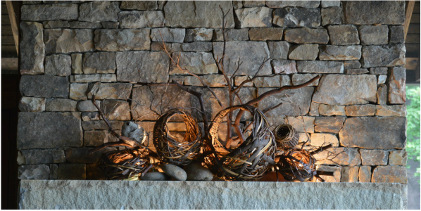 Grapevine rustic sculpture baskets by matt tommey for fireplace mantel.