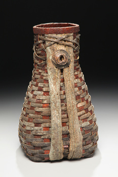 Red And Brown Fluted Basket As Example Of Rustic Sculptures