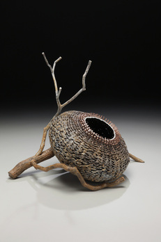 Basket In A Branch As Rustic Sculptures